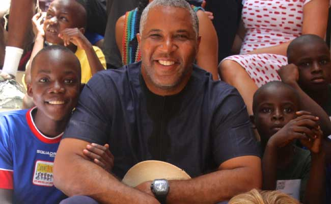 Robert F. Smith, a supporter of the Zanmi Beni Foundation, visits children in Haiti.